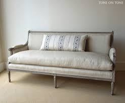 antique sofa recovered in linen with down filled cushion have a