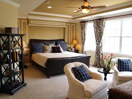 luxurious master bedroom decor with warm paint color and ceiling