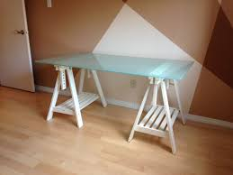 ikea glass desk top with adjule white trestle legs ikea glasholm glass table top