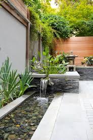 exterior design small backyard pond with cedar fence and stone