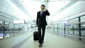 business traveller images Wireless cloud smart phone email communications asian chinese jpg