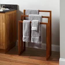 Laminate Wood Flooring For Bathroom Wonderful Wood Bathroom Towel Racks With Some Towels Above