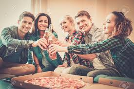 group of young multi ethnic friends with pizza and bottles of