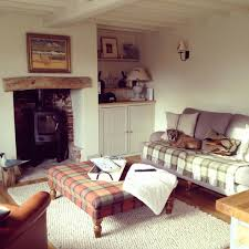 bed in the living room living room cottage sitting room ideas morespoons and living