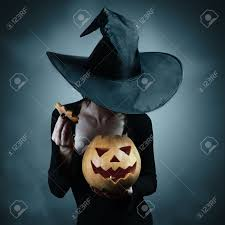 halloween stock footage woman in witch costume opens carved halloween pumpkin stock photo