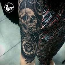 black and gray skull tattoos by pete terranova tattoos and