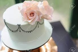 flower fondant cakes white fondant cake with pink flower as decoration stock photo