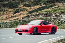 porsche 911 front mercedes amg gts vs porsche 911 gts 2015 review by car magazine