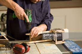man making a wooden toy truck stock photo getty images