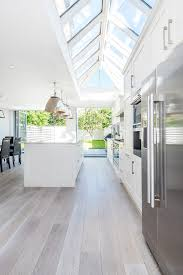 Wood Floor Kitchen by Vaulted Sky Windows In Kitchen White Washed Wood Floor White