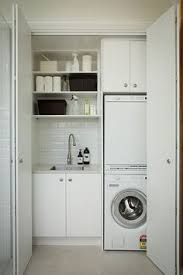 Laundry Cabinet With Hanging Rod Short On Space In The Laundry Room Try One Of These Simple Ideas