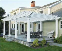 Building A Pergola Attached To The House by Attached Pergola With Pillar Posts Traditional Patio Boston