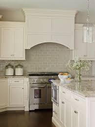 see the beautiful neutral subway tile backsplash in this kitchen