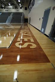 Gym Floor Refinishing Supplies by Douglas County High Stained Gym Floor Boarders U0026 Logo 4