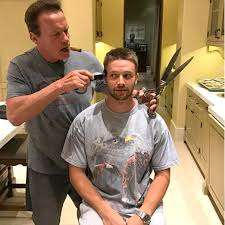 www womenwhocutflattophaircutson arnold schwarzenegger gives son patrick at home haircut people com