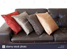 Leather Sofa Cushions Four Colorful Cushions On Brown Leather Stock Photo