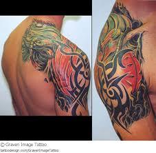 designs biomechanical tribal tattoos on back shoulder for
