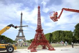 stack carefully chairs form eiffel tower replica nbc news