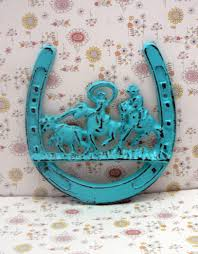 horse shoe cast iron cowboy country roundup scene turquoise wall