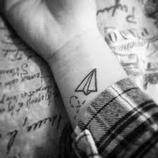 plane tattoo on the left inner wrist