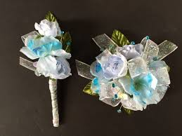 silk wrist corsage boutonnière in light blue turquoise white
