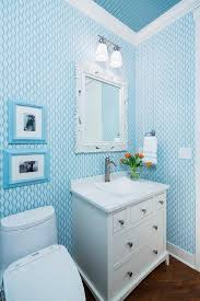 white and navy powder room with nautical wallpaper transitional