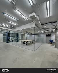 bright office in a loft style with glowing lamps gray brick walls