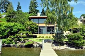 modern house on the lake with a flat green roof and a fantastic