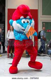 person wearing papa smurf costume stands