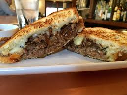 braised short rib grilled cheese on sourdough with caramelized