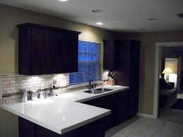 decoration stylish white countertop and dark kitchen cabinet with