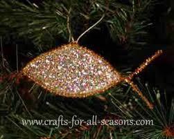 jesus fish ornament pipe cleaner glue glitter and plastic wrap