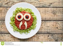 funny creative halloween food monster green spaghetti pasta with
