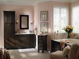 dark brown wooden bathroom vanity on beige tile floor and