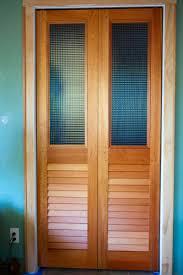 Making Bi Fold Closet Doors by The Hunted Interior Bye Bye Louvered Doors Hello Paneled