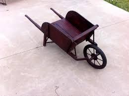Wooden Wheelbarrow Planter by Refurbished Pallet Wheelbarrow Planter 99 Pallets