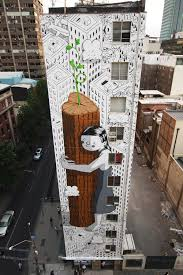 an eleven story tree hugger sprouts on the side of a building
