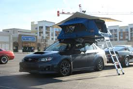 baja subaru impreza sti with a tent rack thing from this morning subaru