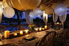 brown wedding reception table decor with paper lanterns above the