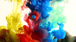 paint mixing together to form wonderful abstract background stock