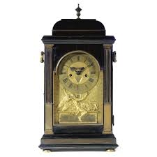 a gilt brass mounted ebony quarter repeating table clock claudius