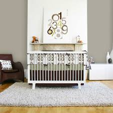 Nursery Rug Ideas Extraordinary Grey Furry Rug And White Wooden Baby Crib Also Brown