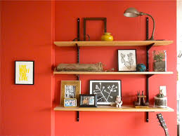 floating brown wooden shelves with black steel handler for picture