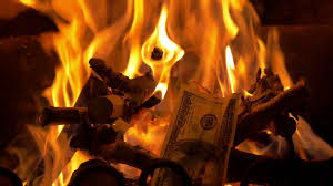 high quality video of throwing money to fireplace in 4k stock