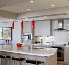 white kitchen with bar has supported by led ceiling lighting on
