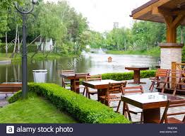 modern restaurant with wooden furniture in the green park near the