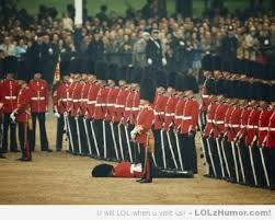 Funny British Memes - guard faints during ceremony other guards remain unwaiveringly