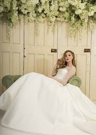 mikado ball gown with beaded illusion neckline and long sleeves