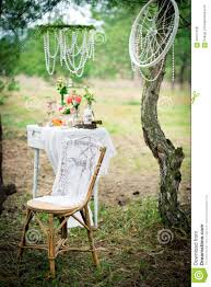 ancient chair against wedding decoration in style of a shabby