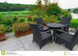 Sofa And Table Set by Rattan Sofa And Table Set In A Garden Stock Photo Image 83891486